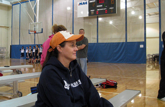 Susan Evans, Jerry's mom, watches basketball practice.