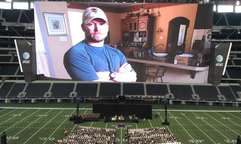 Former Navy SEAL Chris Kyle was celebrated as a gentle and funny father and friend in a series of photos on the massive screen at Cowboys Stadium.