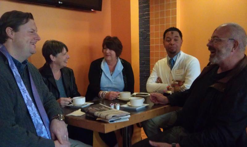 Senior Pastor Frank Drenner (left) talks with people at Zaguan Latin Cafe on Ash Wednesday.