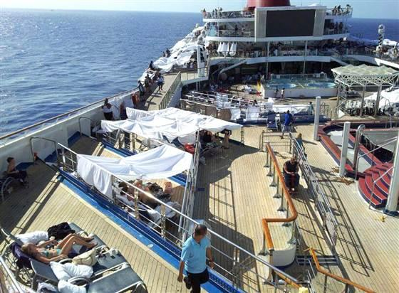 The deck of the stricken cruise ship became a tent city as passengers slept outside because of lack of ventillation in cabins.