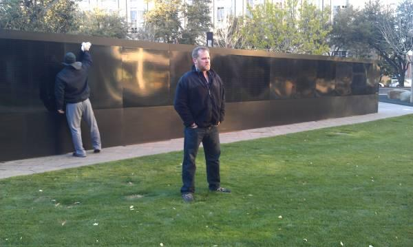 Ron White stands in front of the board where he'll write 2,200 names of soliders who perished in Afghanistan on the tour White himself served in 2007.