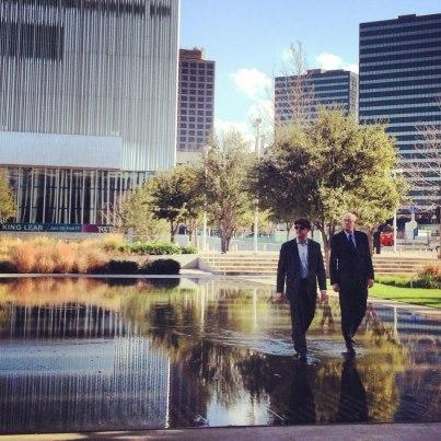 "The stars of ""Wait Wait ... Don't Tell Me,"" Peter Sagal (left) and Carl Kasell, make a pilgrimage across the reflecting pool outside the Winspear Opera House in Dallas."