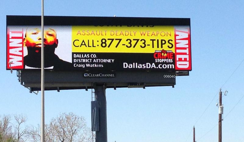 One of the billboards in Dallas displaying a wanted domestic violence suspect.
