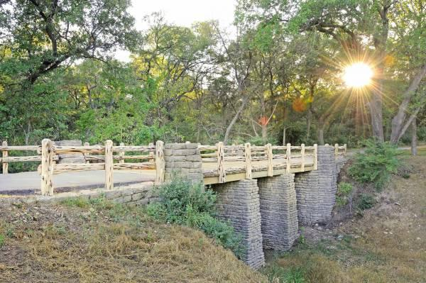 Members of the Civilian Conservation Corps built the Camp Creek Bridge in 1936 inside Cleburne State Park. It was renovated last year with former CCC enrollees attending.
