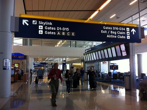 Travelers move through DFW's D Terminal