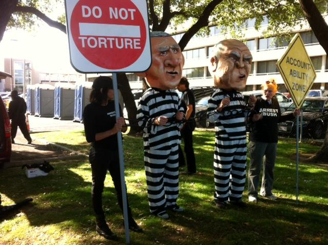 The 'bobbleheads' before their misdemeanor arrest on pedestrian in a right of way charges.