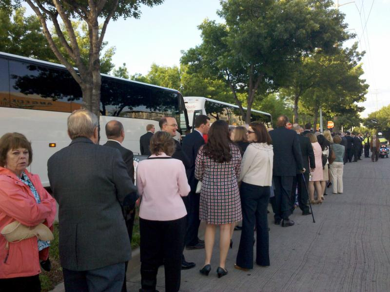 Hundreds attending the Bush Center dedication wait in line for a ride from DART's Mockingbird Station.
