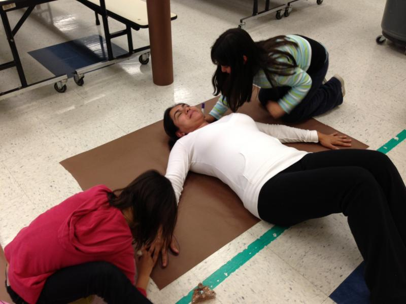 """Students at Seguin Elementary traced their moms on butcher paper to create """"gingerbread hugs"""" for the students in West ISD."""