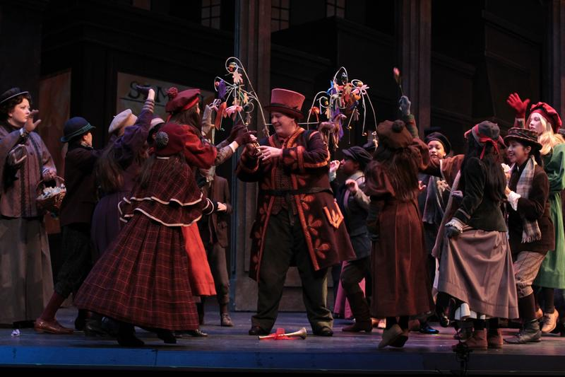 "The kids in the children's chorus crowd on stage during the Fort Worth Opera's ""La Boheme."""