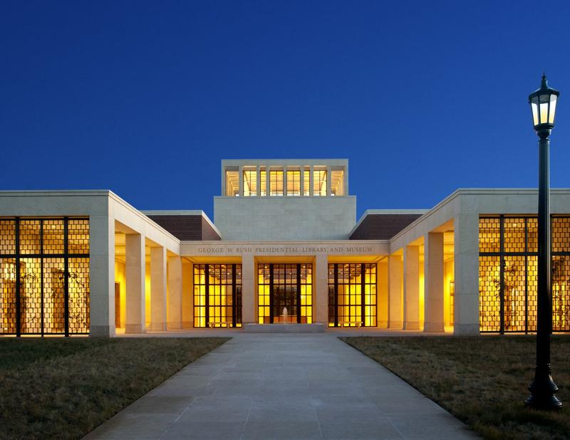 The George W. Bush Presidential Library And Museum lit up at night.