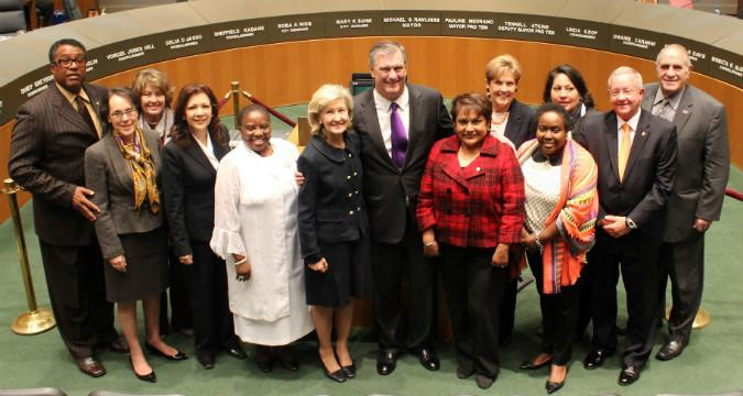 Former Senator Kay Bailey Hutchison with Dallas Mayor Mike Rawlings (c) flanked by members of City Council