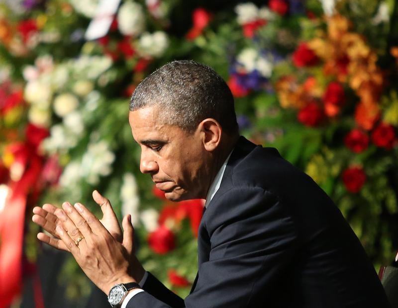 President Barack Obama, mourning with families and other first responders at Memorial in Waco