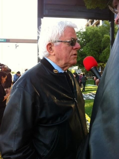 Phil Donahue is with the protesters gathered for today's dedication of the Bush Library.