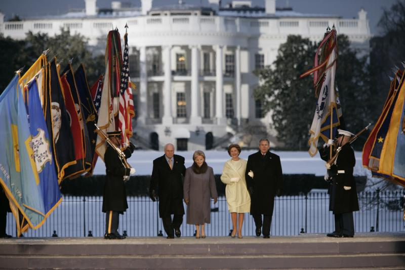 A digital photo from the White House archive of President George W. Bush, Mrs. Laura Bush, Vice President Dick Cheney and Mrs. Lynn Cheney on stage, January 19, 2005, during inauguration festivities on the Ellipse in Washington D.C.