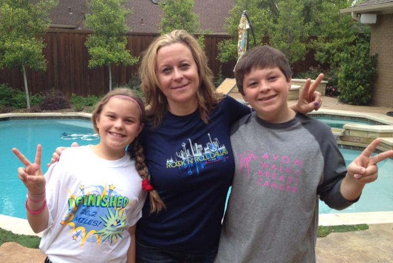 Jen Huddleston and her children, Lili and Evan, show their support for Monday's bombing victims.