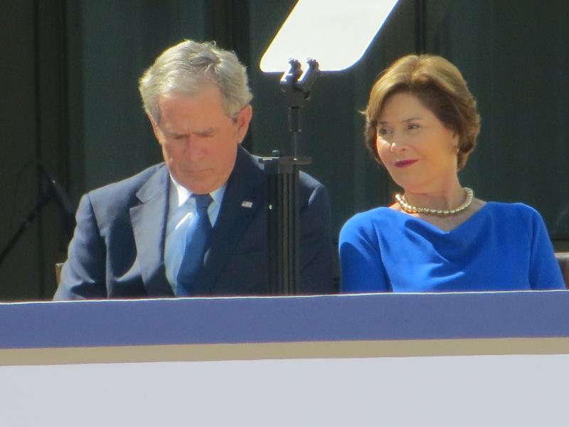 An emotional George W. Bush hears affirmation from living former presidents with his wife Laura at his side.