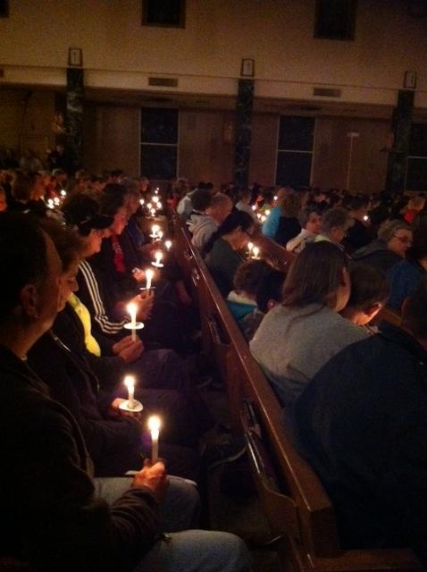Hundreds of people in West attended a candlelight vigil at St. Mary's Assumption Catholic Church Thursday night.