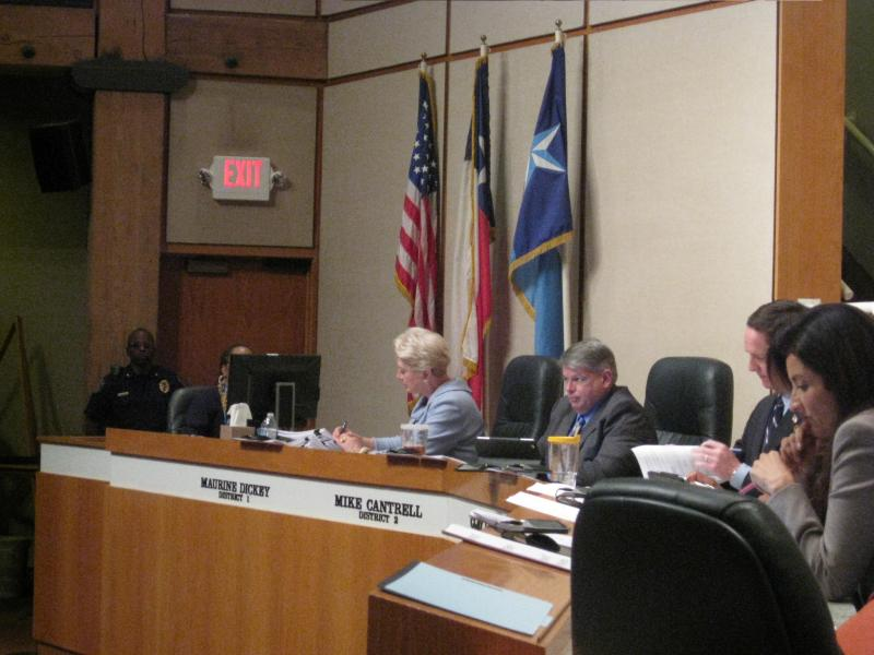 Former Commissioner Maurine Dickey, in blue,  and Commissioner Mike Cantrell, to her right, voted against the same-sex benefit package last October. But the majority, led by Democratic Judge Clay Jenkins, to Cantrell's right, approved it.