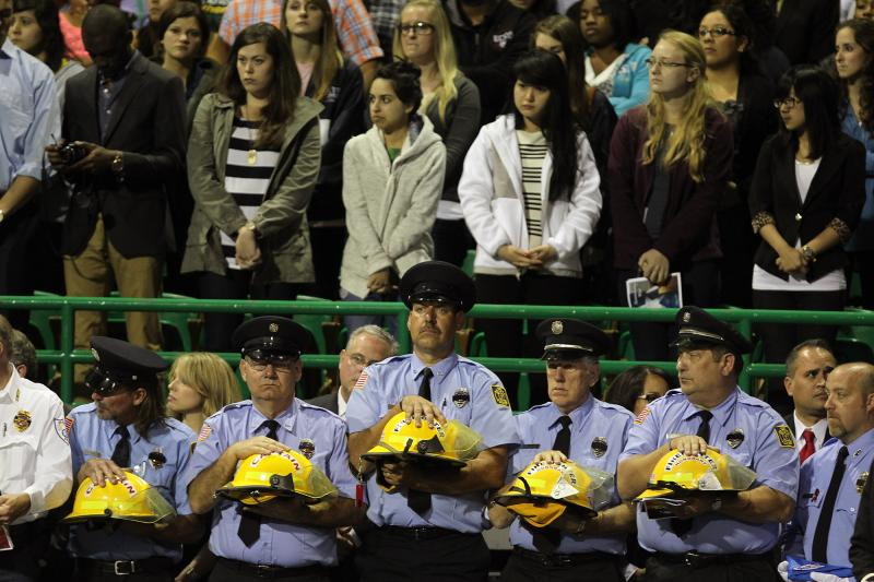 Firefighters at Waco Memorial preparing for helmet presentation