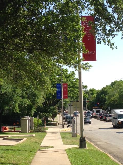Banners along Hillcrest welcome the library to the SMU community.