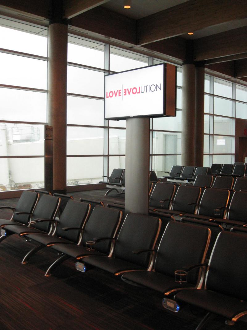 Part of the new Love Field terminal, where seats have cup holders, and every other one offers a power outlet and USB port