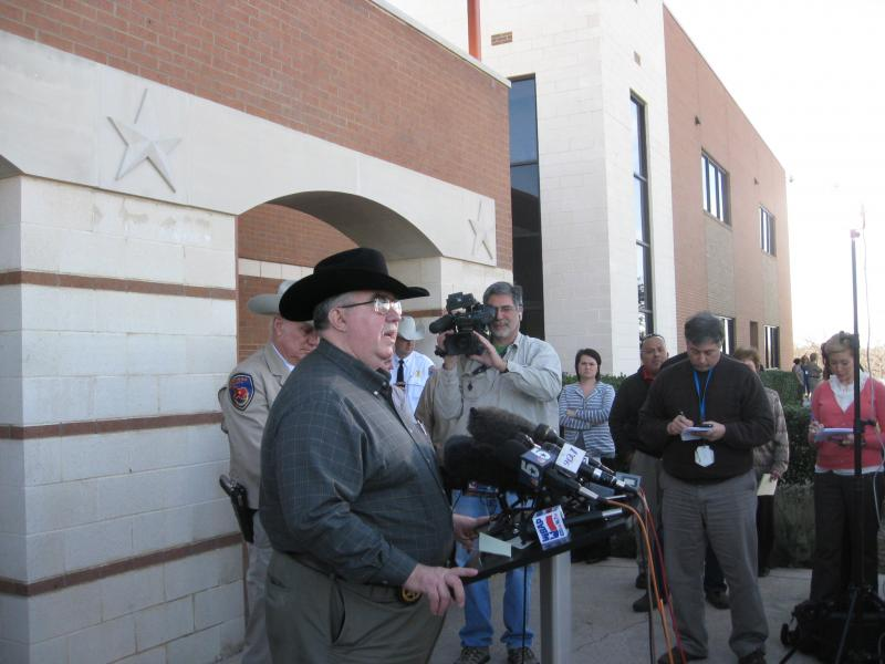 The late Kaufman County DA Mike McLelland, addressing reporters in January after his Assistant DA Mark Hasse was gunned down walking to work.