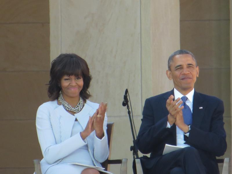 President Barack Obama and First Lady Michelle Obama applauded Bush at the dedication Thursday.