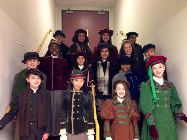 The 16 members of the children's chorus backstage.
