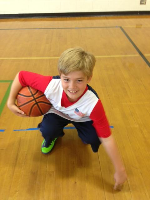 His screaming green basketball shoes are embroidered with his lucky number, 13.