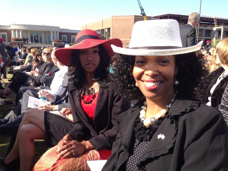 When the skies cleared for the Bush Center dedication, the fancy hats came out. Nekima Booker (left) is chair of the Veterans Coalition of North Central Texas, and Tracy Little is director of Dallas County Veteran Services.