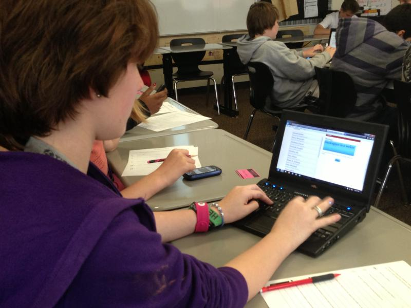 Students in a U.S. history class at Tidwell Middle School are given the option of using their smart phone or netbook to work on an assignment.