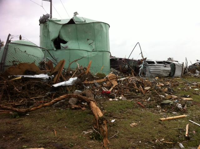The EF 4 tornado tossed trees, cars and homes, turning the whole neighborhood into a debris field.