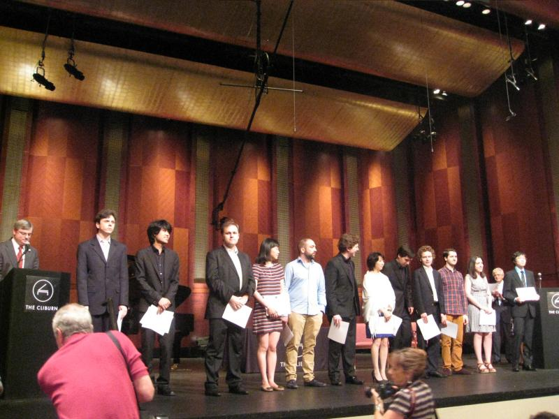 The twelve young semi-finalists of the 14th Van Cliburn International Piano Competition, on stage at Bass Hall, in Fort Worth