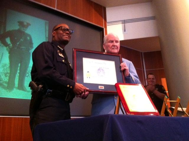 Dallas Police  Chief David Brown presents former Detective James Leavelle with the Police Commendation Award.