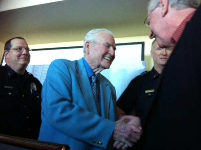 James Leavelle (c) shakes hands with longtime acquaintance, former reporter Jim Ewell