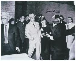 Pulitzer Prize winning Dallas Times Herald photo of Jack Ruby shooting Lee Harvey Oswald who was handcuffed to Dallas Police Detective James Leavelle.