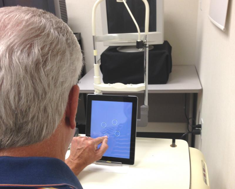 The FDA-approved MyVisionTrack test has the ability to track vision loss in patients with retinal disorders. Patient Daniel Agnew, who has diabetic retinopathy, uses the device to differentiate between circles on the screen.