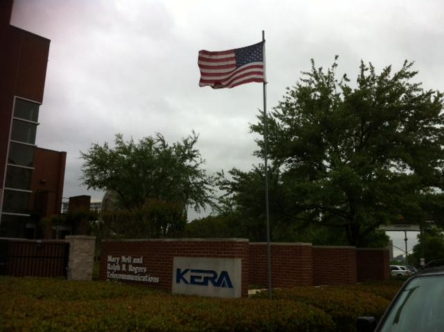 North winds with gusts up to 40mph whip the American flag outside the KERA studios.
