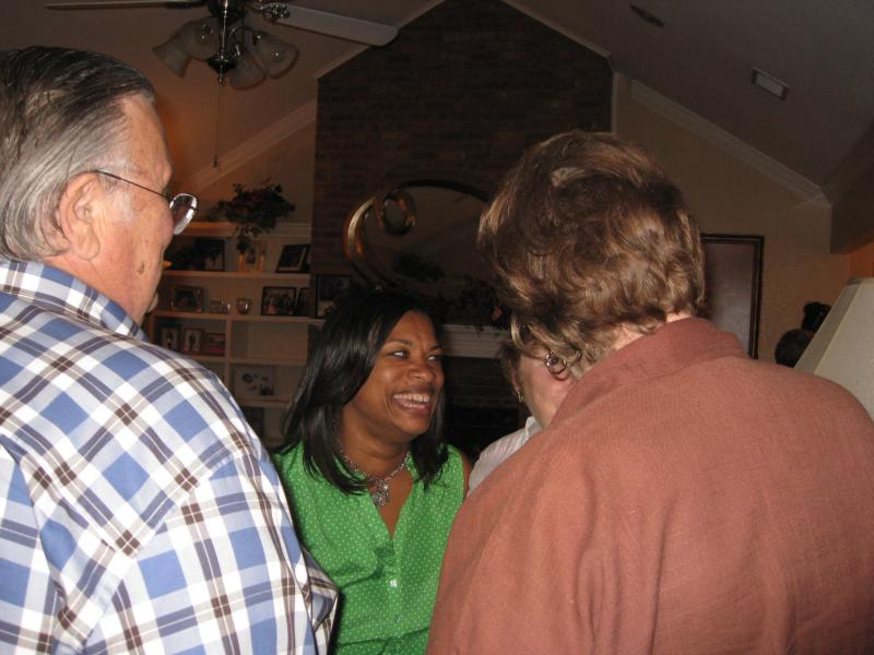 Kelly Allen Gray, in green, the happy, victorious Fort Worth Councilwoman, amidst supporters in her home.