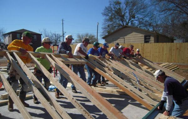 Volunteers for Hood County Habitat for Humanity work on a home in Granbury just two months ago.