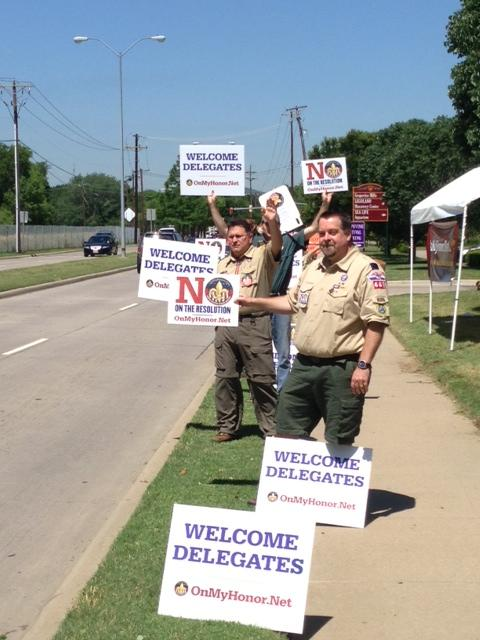 Protestors held signs urging delegates to vote no.