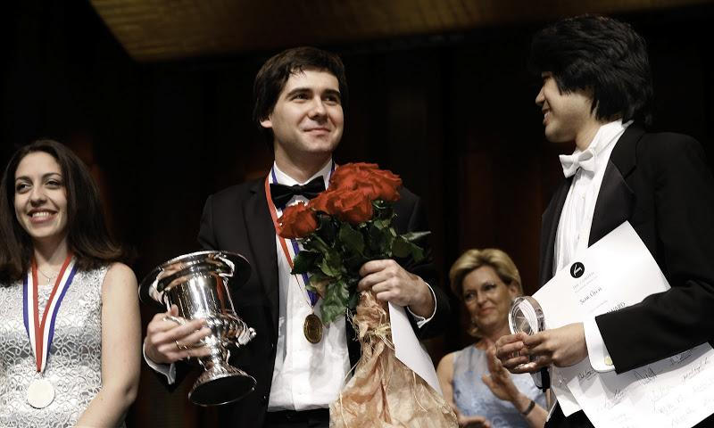 Cliburn gold medalist Yadym Kholodenko stands with silver medalist Beatrice Rana of Italy and 3rd place winner Sean Chen, of the U.S.