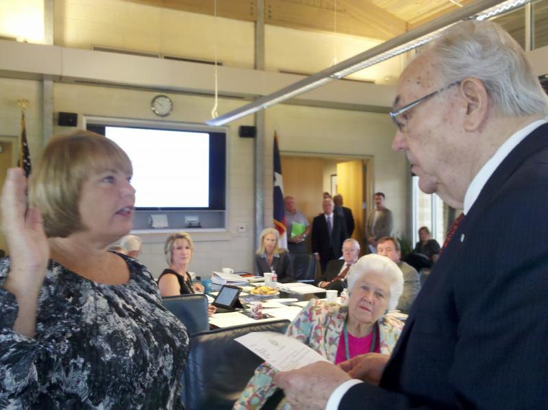 New board member Mary Kelleher was sworn in by Tarrant Regional Water District Board  President Victor Henderson.