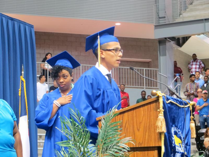 Richard Flores leads graduating class in the Pledge of Allegiance.