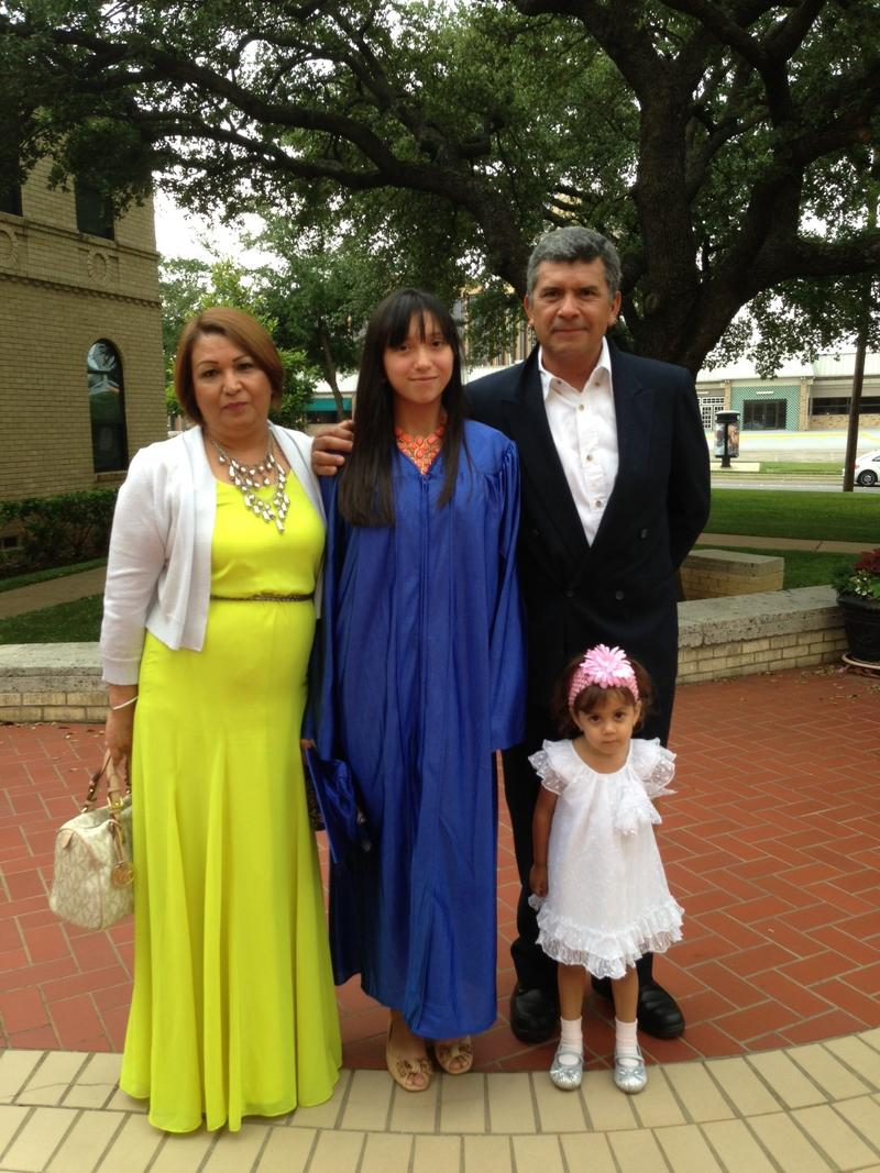Alex Gutierrez with her parents, Rocio and Jose, and niece, Mia, on the day of her 8th grade graduation at Holy Trinity Catholic School.