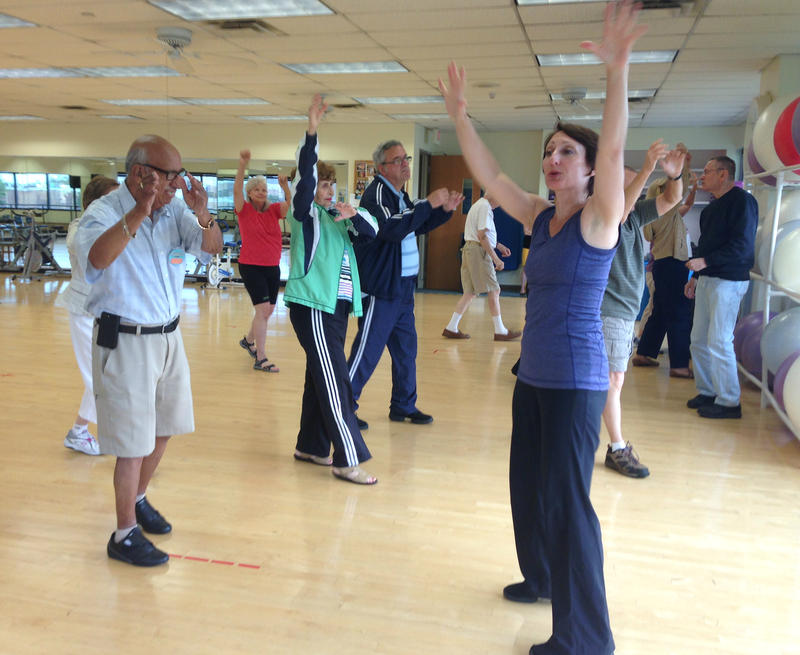 Dance instructor Misty Owens (right) leading the class for movement disorder patients at Texas Health Presbyterian Hospital in Dallas.