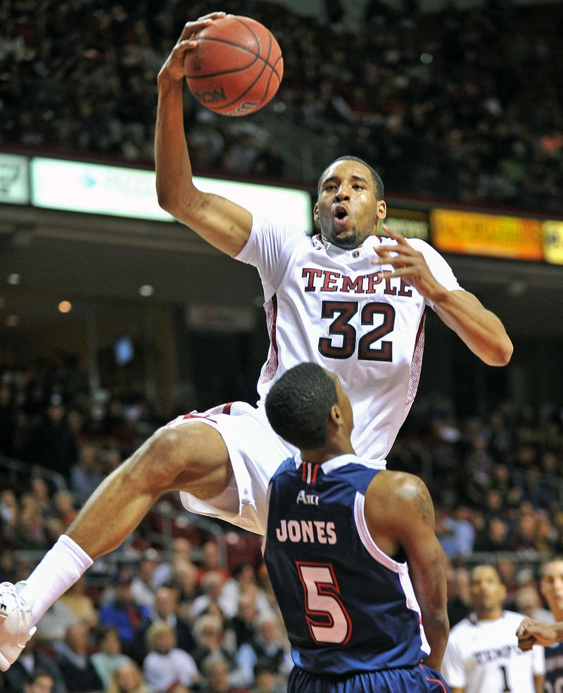 "A classic basketball ""flop"" has the defender falling, to draw a foul, before the offensive player makes contact. In this photo from 2012, Duquesne's Jerry Jones (5) tries to take a charge from Temple's Rahlir Hollis-Jefferson during the 2012 NCAA season."