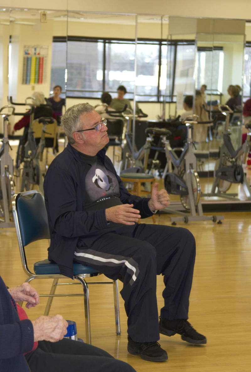 Jim Rosenbloom warms up during dance class.