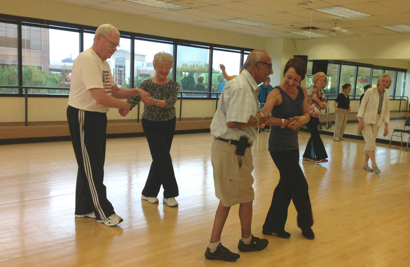Joe Cuevas (right in shorts) dances with instructor Misty Owens. Cuevas was diagnosed with Parkinson's ten years ago and has been coming to this dance class for almost two years.