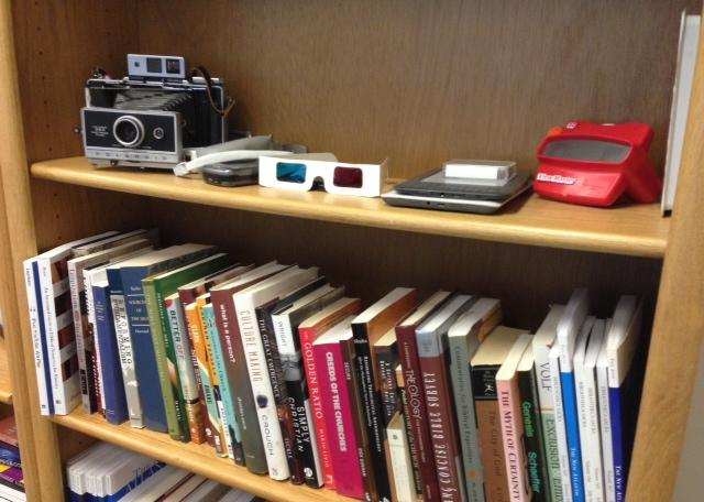 The technology shelf in Dyer's office.